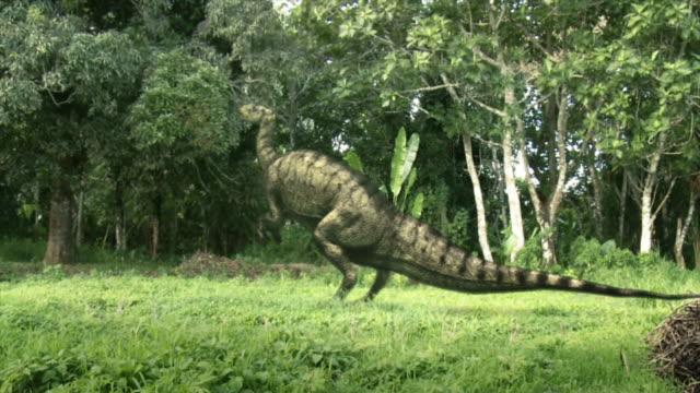 Medium Long Shot static - Silhouetted dinosaurs stalk a Tyrannosaurus Rex in a computer-generated animation. / Washington, DC, USA
