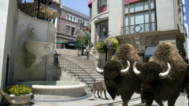 Medium Long Shot static - The Spanish Steps of Rodeo Drive disappear behind a buffalo herd in a computer-generated animation. / Los Angeles, California, USA