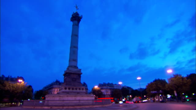 medium long shot tracking-right - street lamps surround the july column in paris at night. / paris, france - bastille paris stock videos & royalty-free footage