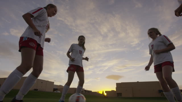medium low angle shot of girls practicing passing soccer ball / springville, utah, united states - springville utah stock videos & royalty-free footage