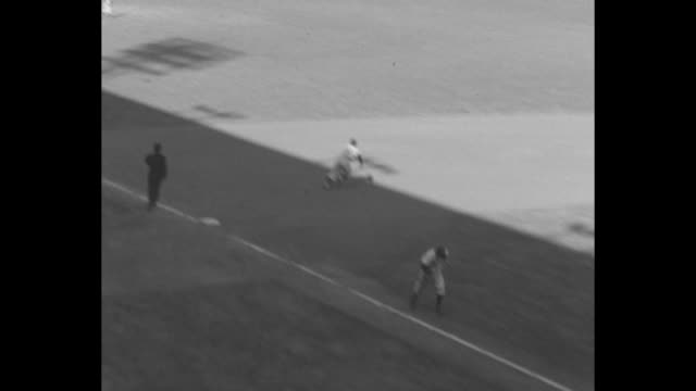 medium cu of mostly men in stands watching game 2 of the world series at shibe park in philadelphia / new york yankees player scores run / mike... - philadelphia phillies stock-videos und b-roll-filmmaterial