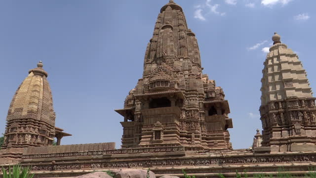 medium, ornate domes of the khajuraho temples, india - temple building stock videos & royalty-free footage