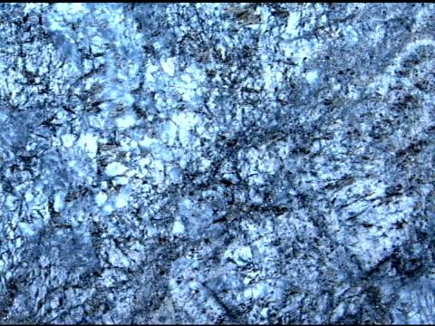 medium pan left across blue-silver toned granite stone. - igneous stock videos & royalty-free footage