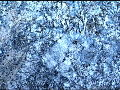 medium pan right across blue-silver toned granite stone. - igneous stock videos & royalty-free footage