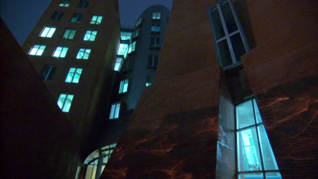 medium pan-left pan-right - the unconventional exteriors of mit smart buildings help provide energy self sufficiency. / cambridge, ma - self sufficiency stock videos and b-roll footage