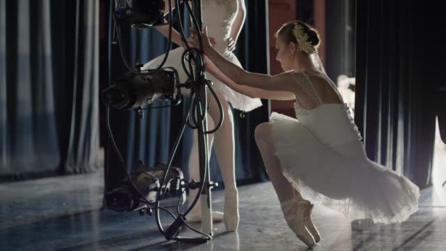 medium panning shot of ballerina stretching en pointe backstage / salt lake city, utah, united states - en pointe stock videos and b-roll footage