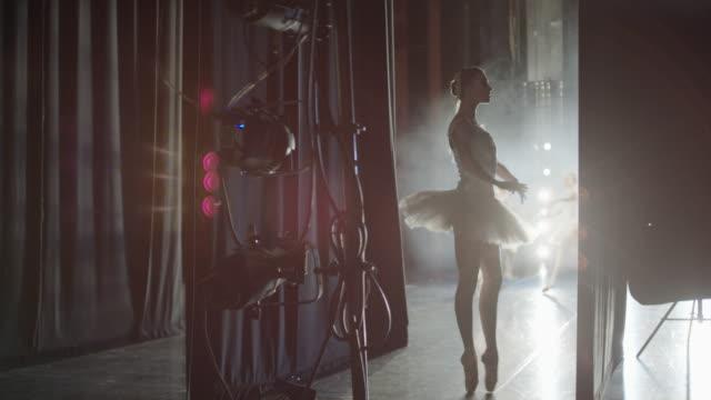 Medium panning shot of ballerina waiting backstage / Salt Lake City, Utah, United States