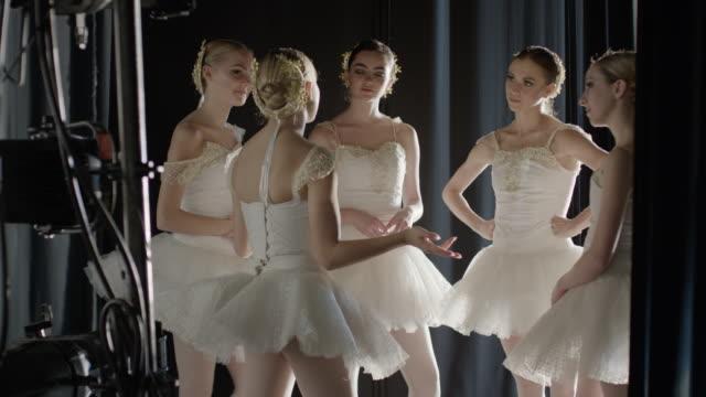 Medium panning shot of ballerinas talking backstage / Salt Lake City, Utah, United States