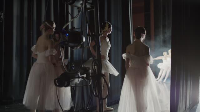 medium panning shot of ballerinas waiting backstage / salt lake city, utah, united states - backstage stock videos and b-roll footage