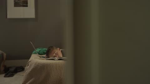 medium panning shot of boy sleeping during homework in bedroom / cedar hills, utah, united states - sleeping stock videos & royalty-free footage
