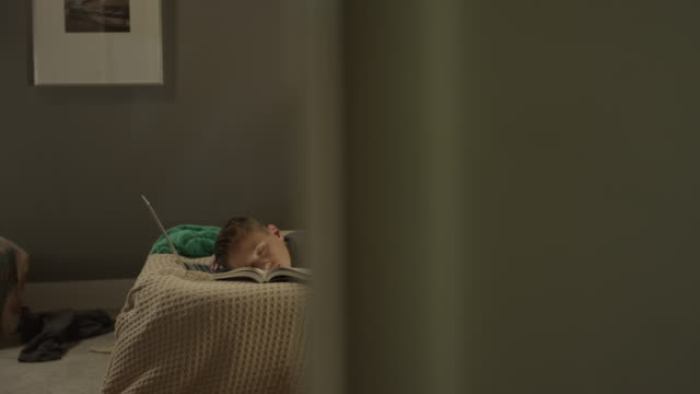medium panning shot of boy sleeping during homework in bedroom / cedar hills, utah, united states - bedroom stock videos & royalty-free footage
