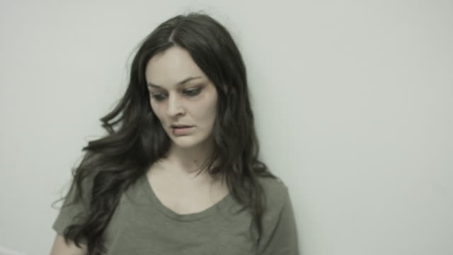 vídeos de stock e filmes b-roll de medium panning shot of domestic violence victim on floor of bathroom / springville, utah, united states - springville utah
