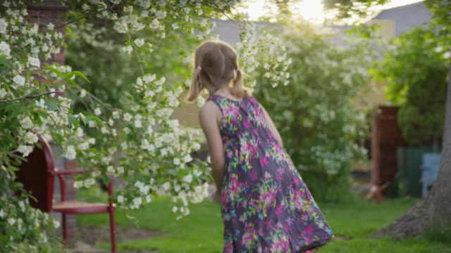 medium panning shot of girl dancing in yard / springville, utah, united states - springville utah stock videos & royalty-free footage