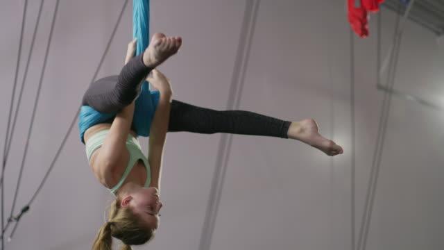 medium panning shot of girl practicing on aerial silks / midvale, utah, united states - leggings stock videos & royalty-free footage