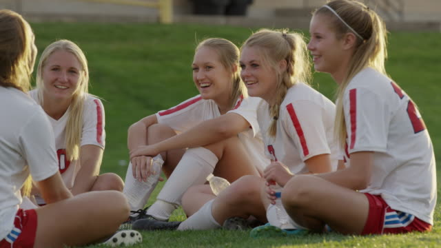 medium panning shot of girls laughing after soccer match / springville, utah, united states - teenagers only stock videos & royalty-free footage