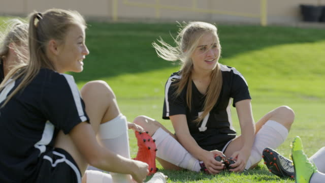medium panning shot of girls warming up for soccer / springville, utah, united states - springville utah stock videos & royalty-free footage