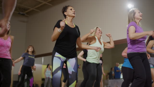 medium panning shot of people dancing in exercise class / orem, utah, united states - weitere themen stock-videos und b-roll-filmmaterial