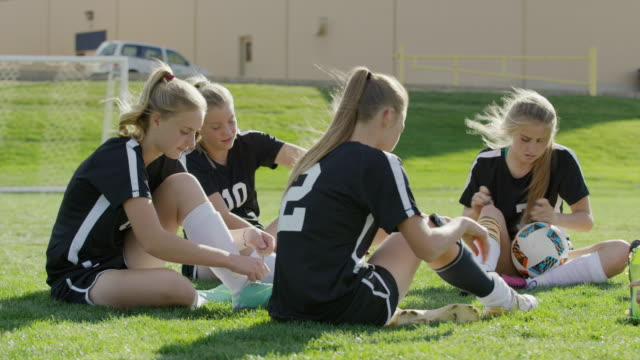 medium panning shot of players preparing for soccer / springville, utah, united states - springville utah stock videos & royalty-free footage