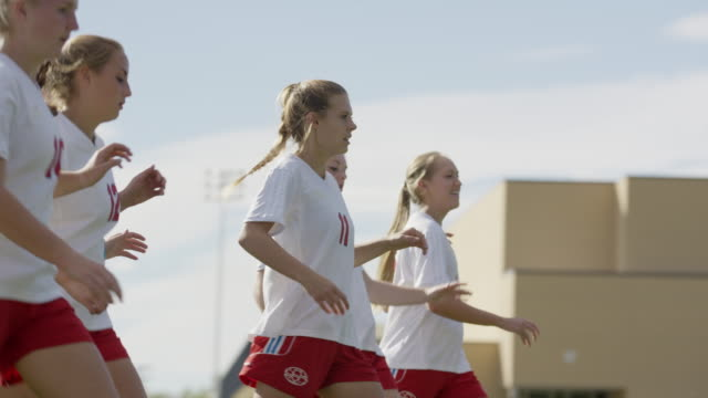 medium panning shot of soccer players practicing kicking / springville, utah, united states - springville utah stock videos & royalty-free footage