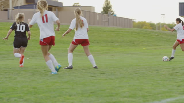 medium panning shot of soccer team celebrating goal / springville, utah, united states - springville utah stock-videos und b-roll-filmmaterial