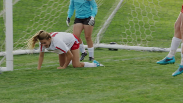 medium panning shot of soccer team celebrating goal / springville, utah, united states - persona di sesso femminile video stock e b–roll