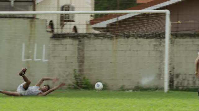 medium panning shot of soccer team celebrating score / esterillos, puntarenas, costa rica - defender soccer player stock videos and b-roll footage