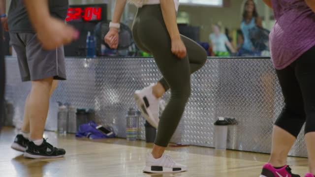 vidéos et rushes de medium panning shot of students dancing in exercise class / orem, utah, united states - autre thème