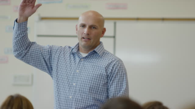 medium panning shot of teacher talking in high school classroom / mapleton, utah, united states - teacher stock videos & royalty-free footage