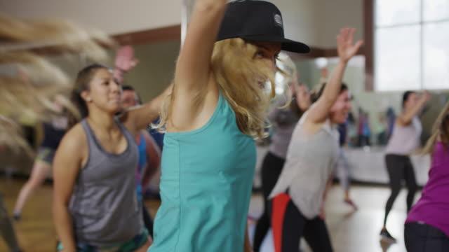 medium panning shot of women dancing in exercise class / orem, utah, united states - weitere themen stock-videos und b-roll-filmmaterial