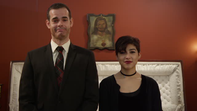 medium portrait shot of owners of a funeral parlor - pompe funebri video stock e b–roll