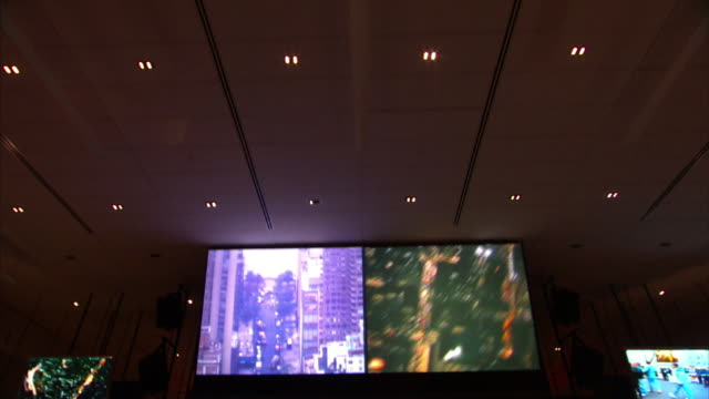 Medium push-in - Surveillance screens monitor activity in New York City. / New York City, New York, USA