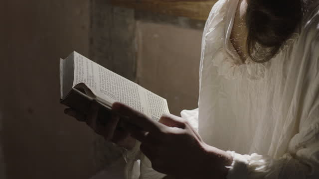 medium reenactment shot of a person reading a book during the 17th century - 17th century stock videos & royalty-free footage