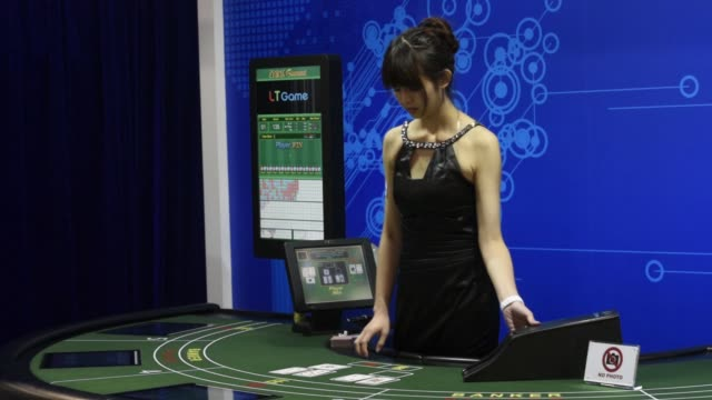 vídeos de stock, filmes e b-roll de medium shot a dealer lays out cards at a baccarat table at the macao gaming show in macau china on tuesday nov 17 wide shot a dealer lays out cards... - game show