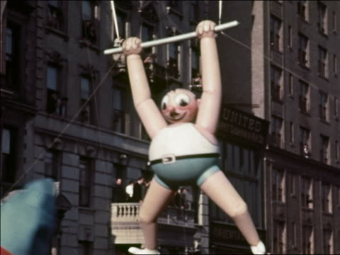 1937 medium shot acrobat on trapeze balloon in macy's thanksgiving day parade / new york city - 1937 stock videos and b-roll footage