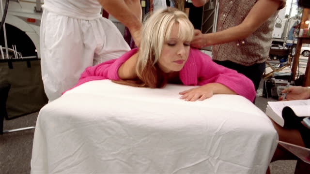 vídeos y material grabado en eventos de stock de medium shot actress on massage table having hair and makeup done / being offered platter of sushi - massage table