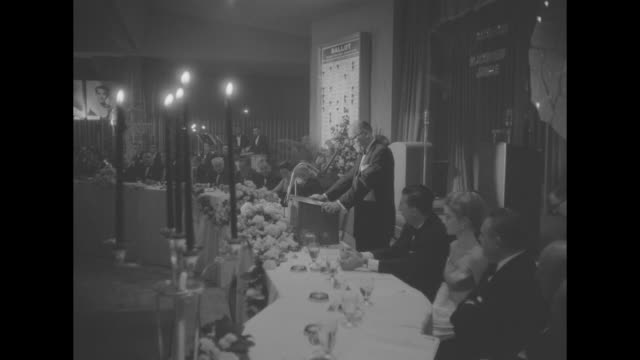 medium shot and close up shot elmer rhoden speaks at podium between two candlelit head tables - ballroom stock videos & royalty-free footage