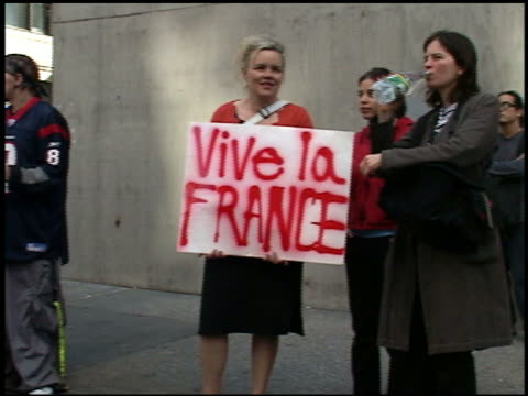 "medium shot anti-war protesters holding ""vive la france"" placard / new york city - 20 29 years stock videos & royalty-free footage"