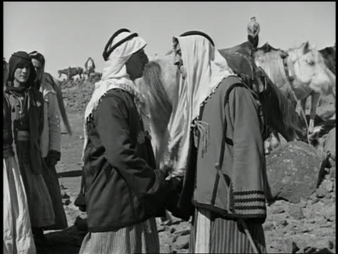 1932 medium shot arab men greeting each other by kissing numerous 1932 medium shot arab men greeting each other by kissing numerous times stock footage video getty images m4hsunfo