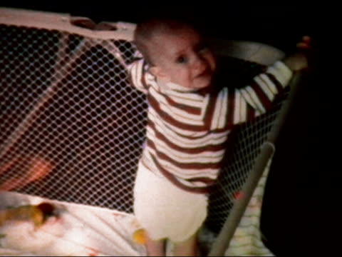 1972 medium shot baby in crib - nappy stock videos and b-roll footage