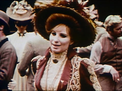 vídeos de stock, filmes e b-roll de 1969 medium shot barbra streisand on the set of 'hello dolly' sticking out her tongue out and smiling - atriz