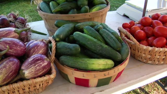medium shot baskets of cucumbers at farmers' market - cucumber stock videos & royalty-free footage
