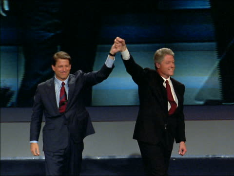 vídeos de stock e filmes b-roll de medium shot bill clinton and al gore shaking hands / clasping hands + waving onstage - 1992