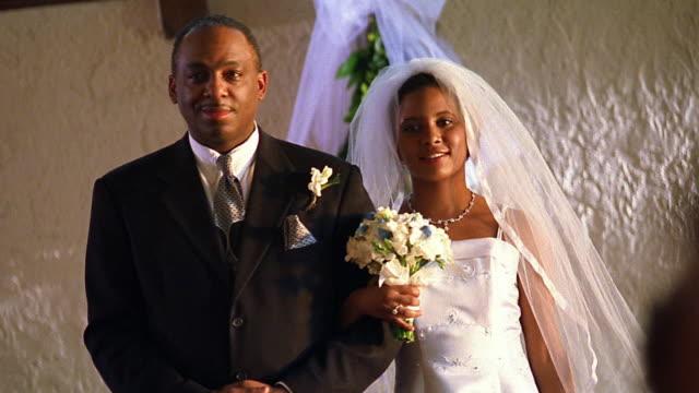 Medium shot Black father giving away bride