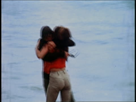 medium shot bob denver and michele carey embrace + fall into the ocean - 30 39 years stock videos & royalty-free footage