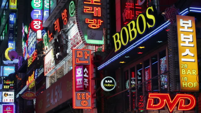 medium shot bobos bar and other neon street signs in insa dong district at night / seoul, south korea - neon stock videos & royalty-free footage