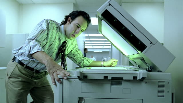 medium shot bored office worker making photocopies - boredom stock videos & royalty-free footage