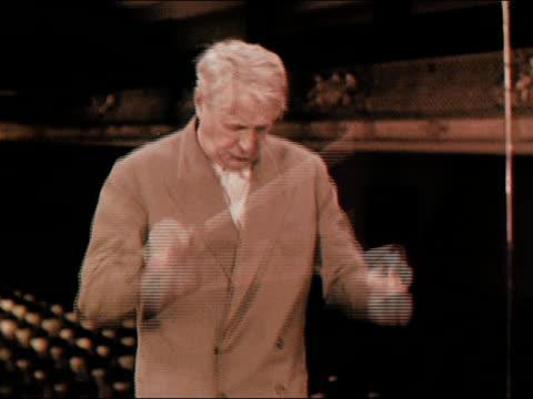 medium shot boston symphony orchestra conductor charles munch conducting with baton/ audio - human limb stock videos and b-roll footage