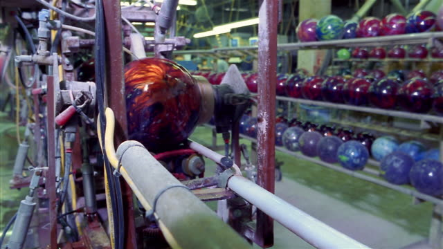 medium shot bowling ball spinning and being polished / rolling down production line / san antonio, texas - bowling ball stock videos & royalty-free footage