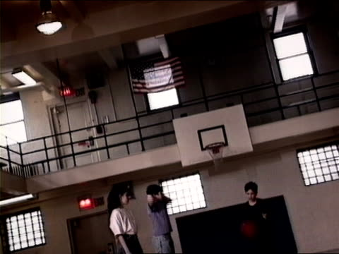 medium shot boy throwing and catching ball during gym class dodgeball game/ new york city - 1994 stock videos and b-roll footage
