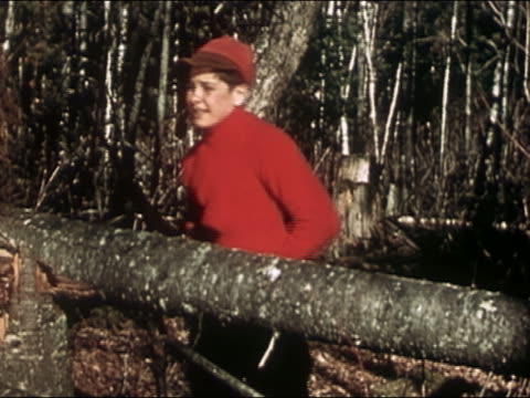 1946 medium shot boy wearing hunting gear aiming shot gun / waiting to get a better look / audio - teenage boys stock videos & royalty-free footage